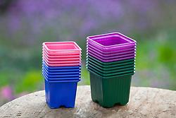 Pile of coloured plastic pots