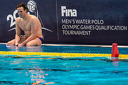 Robin Lindhout of the Netherlands disappointed against Montenegro during the Olympic qualifying tournament. The Dutch water polo players are on the hunt for a starting ticket for the Olympic Games on February 19, 2021 in Rotterdam