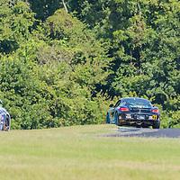 Alton, VA - Aug 26, 2016:  The Bodymotion Racing Porsche Cayman races through the turns at the Oak Tree Grand Prix at Virginia International Raceway in Alton, VA.