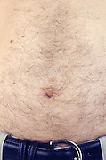 close up of a white man's belly
