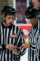 KELOWNA, BC - MARCH 7: Line official Dave McMahon goes over a call with referee Chris Crich at the Kelowna Rockets against the Lethbridge Hurricanes at Prospera Place on March 7, 2020 in Kelowna, Canada. (Photo by Marissa Baecker/Shoot the Breeze)