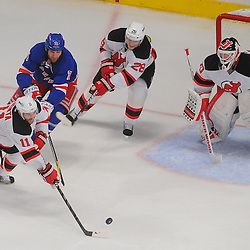 May 14, 2012: New Jersey Devils right wing Stephen Gionta (11) clears a rebound off of goalie Martin Brodeur (30) away from New York Rangers left wing Mike Rupp (71) during second period action in game 1 of the NHL Eastern Conference Finals between the New Jersey Devils and New York Rangers at Madison Square Garden in New York, N.Y.