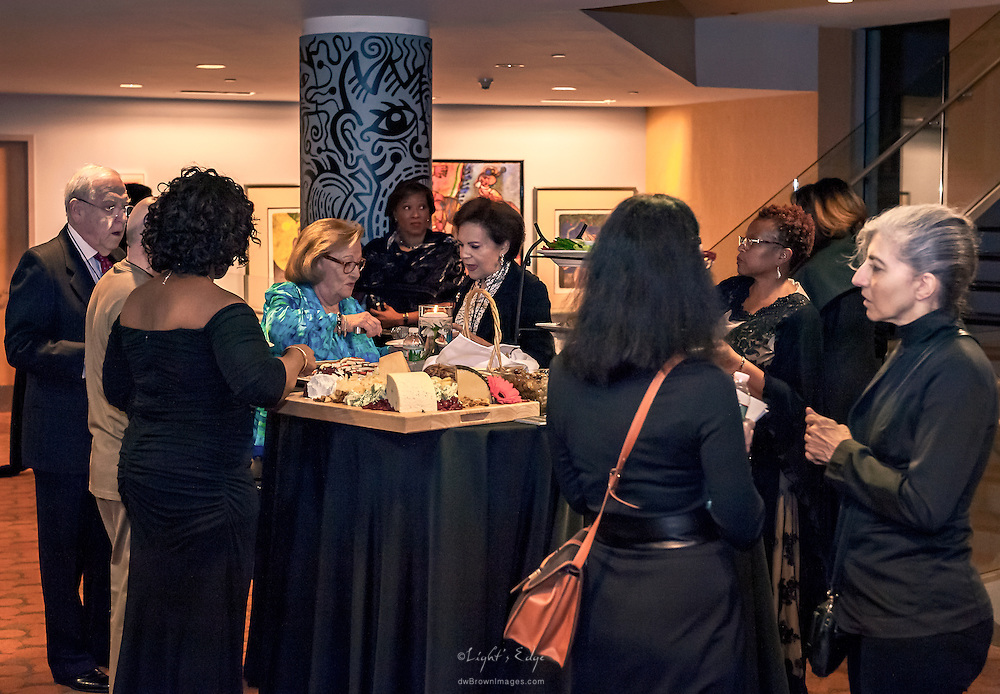 Conversations around a cheese station at the SOPAC 2016 Gala.