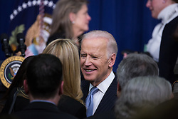 December 13, 2016 - Washington, DC, United States - VP Joe Biden greets guests in the audience, after President Obama signed the 21st Century Cures Act, in the South Court Auditorium of the Eisenhower Executive Office Building of the White House in Washington, DC. on December 13, 2016. The legislation eases the development and approval of experimental treatments and reforms federal policy on mental health care. (Credit Image: © Cheriss May/NurPhoto via ZUMA Press)