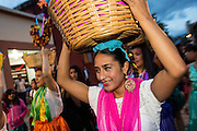 Young women dressed in traditional costumes dance in a comparsas or parade during the Day of the Dead Festival known in Spanish as Día de Muertos on November 2, 2013 in Oaxaca, Mexico.