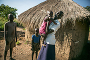 Nyajouk Chuol Bil, left, hugs her one-and-half-year-old daughter after she came back from the school run by UNHCR inside Bidibidi refugee settlement in Uganda. When a small fighting broke out in the summer of 2015, she hid in the UN compound in Juba. When she went outside the compound to buy sandals, she was met with four Dinka soldiers with AK-47. She got pregnant from the rape and gave birth to a daughter. She was separated from her parents and hasn't heard the whereabout of them.  Now a senior 1 grade in the secondary school, she goes to school inside the refugee camp, but worries that there's very few people who could babysit the baby when she is away. She said she wanted to be an accountant or work in a bank in the future.