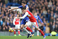 Mesut Ozil of Arsenal and Nemanja Matic of Chelsea compete for the ball. Premier league match, Chelsea v Arsenal at Stamford Bridge in London on Saturday 4th February 2017.<br /> pic by John Patrick Fletcher, Andrew Orchard sports photography.