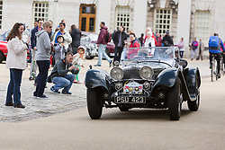 © Licensed to London News Pictures. 27/04/2014. London, UK. People watch as a vintage Jaguar SS100 recreation leaves for the start. Around 250 vintage Jaguar cars set off in a staggered start from the Old Royal Naval College in Greenwich, south east London for the 16th annual London to Brighton rally this morning. Photo credit : Vickie Flores/LNP