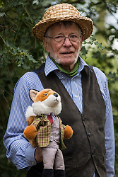 Wendover, UK. 9th May, 2021. A local resident holds a fox toy at an event in Jones Hill Wood billed as an 'Accolade To The Ancients' in tribute to the ancient woodland there which is being felled for the HS2 high-speed rail link. The event featured a reading of an adaptation of Roald Dahl's Fantastic Mr Fox, which it is said he was inspired to write by Jones Hill Wood, as well as poems, speeches and face painting.