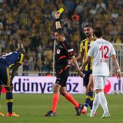 Referee's Bulent Yildirim show the yellow card to Fenerbahce's Selcuk Sahin (2ndR) during their Turkish superleague soccer match Fenerbahce between Balikesirspor at the Sukru Saracaoglu stadium in Istanbul Turkey on Saturday 02 May 2015. Photo by TURKPIX