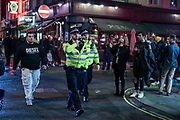Police encourage people to go home as they continue drinking outside a bar in Soho, London on Friday, Oct 9, 2020 -  after the 10 pm curfew. Pubs and restaurants are subject to in order to curb the spread of coronavirus. Boris Johnson is to outline a new three-tiered system of coronavirus restrictions on Monday that is expected to cause pubs and restaurants to shut across the north of England.<br /> (VXP Photo/ Vudi Xhymshiti)