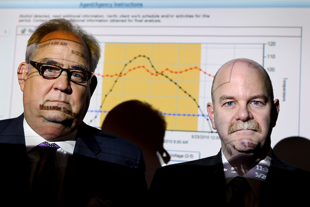 CEO Larry Vanderwoude, left, and COO Vickers L. Cunningham, Sr., a retired criminal district judge, stand in front of an alcohol curve  graph that plots information downloaded from a SCRAM device at Recovery Healthcare Corporation in Dallas, TX.  The SCRAM is an ankle bracelet that monitors alcohol intake via a measurement of alcohol excreted through the skin.  The black line in this graph is that measurement--the transdermal alcohol concentration.