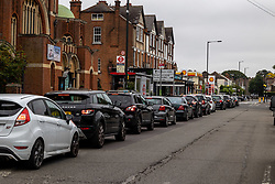 Licensed to London News Pictures. 25/09/2021. London, UK. Long queues with tailbacks over 3/4 mile form on the second day of the fuel crisis at a Shell garage in Wimbledon, south-west London today as desperate motorists stop to fill. Yesterday, petrol stations across London and the South East were on critical levels with many running out of fuel as oil giants struggle to maintain deliveries due to the lack of HGV drivers. Photo credit: Alex Lentati/LNP