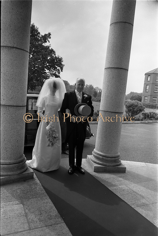 05/07/1967<br /> 07/05/1967<br /> 05 July 1967<br /> Wedding of George Walsh, eldest son of Mr and Ms Kevin G. Walsh, St. Rita's, Firhouse Road, Templeogue, Co. Dublin and Miss Arlene McMahon, elder daughter of Det. Chief Supt. Philip McMahon, Head of Special Branch, Dublin Castle and Mrs McMahon of Lisieux, Templeville Park, Templeogue, Co. Dublin who were married at the Carmelite Church, Terenure College, Dublin. An Taoiseach Mr Jack Lynch and Mrs Lynch; Mr Liam Cosgrave, leader Fine Gael and Mrs Cosgrave were among the 120 guests. Rev Fr H.E. Wright, O. Carm., Moate, officiated at the ceremony. The reception was held at Downshire Hotel, Blessington, Co. Wicklow. Bride and her father Mr. McMahon about to enter the church.