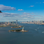 Helicopter view of New York: Statue of Liberty, Manhattan and Hudson river