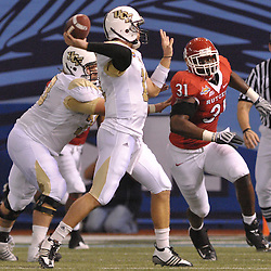 Dec 19, 2009; St. Petersburg, Fla., USA; Rutgers defensive end George Johnson (31) rushes UCF quarterback Brett Hodges (11) during NCAA Football action in Rutgers' 45-24 victory over Central Florida in the St. Petersburg Bowl at Tropicana Field.