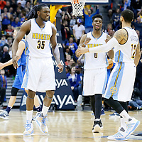 06 March 2016: Denver Nuggets forward Kenneth Faried (35) and Denver Nuggets guard Emmanuel Mudiay (0) celebrate with Denver Nuggets guard D.J. Augustin (12) during the Denver Nuggets 116-114 overtime victory over the Dallas Mavericks, at the Pepsi Center, Denver, Colorado, USA.
