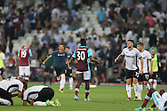Michail Antonio of West Ham United looks on dejected at fulltime as Astra Giurgiu players celebrate. UEFA Europa league, 1st play off round match, 2nd leg, West Ham Utd v Astra Giurgiu at the London Stadium, Queen Elizabeth Olympic Park in London on Thursday 25th August 2016.<br /> pic by John Patrick Fletcher, Andrew Orchard sports photography.