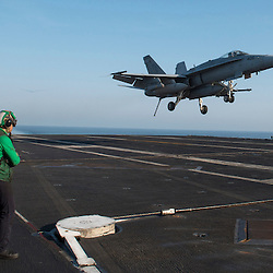 USS John C Stennis CVN-74 Aircraft Carrier.Pic Shows  F-18 Super Hornets come into land after their missions