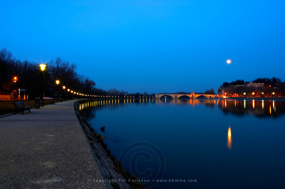 The Pont Saint St Benezet bridge in Avignon on the Rhone at sunset with moon and the river bank, Vaucluse, Rhone, Provence, France