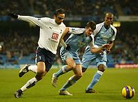 Photo: Aidan Ellis.<br /> Manchester City v Tottenham Hotspur. The Barclays Premiership. 17/12/2006.<br /> Spurs Dimitar Berbatov (L) battles with City's Joey Barton