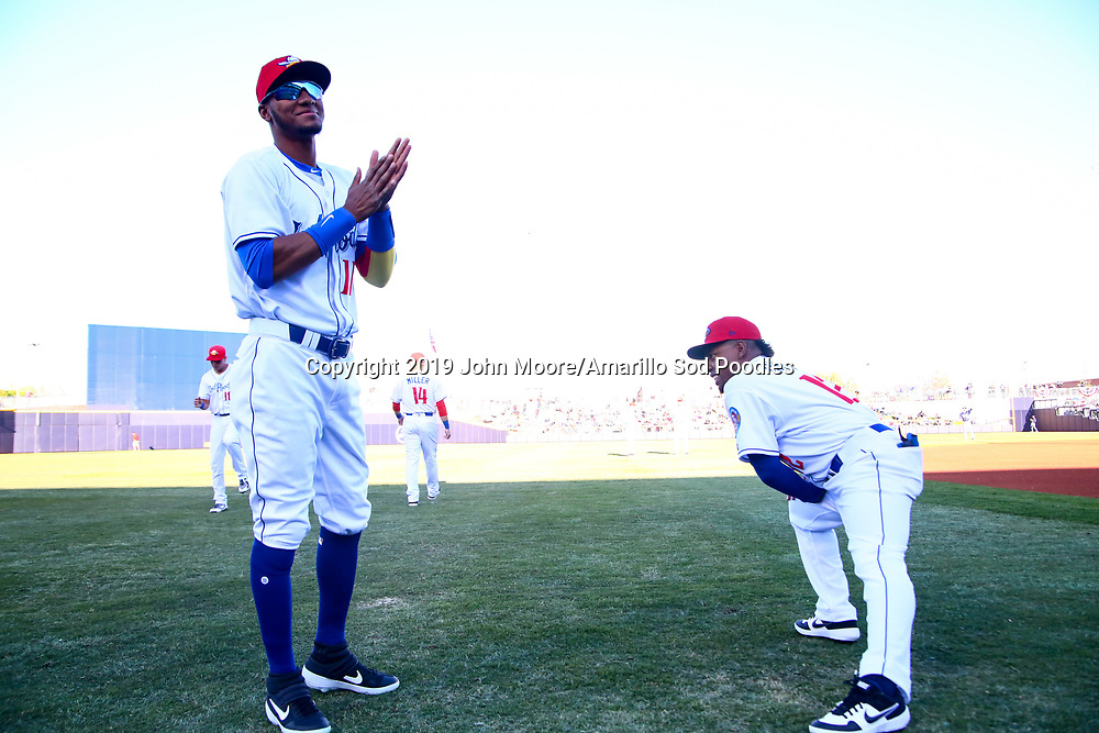 Amarillo Sod Poodles outfielders Edward Olivares (11) and Rodrigo Orozco (12) stretch before the game against the Corpus Christi Hooks on Friday, April 19, 2019, at HODGETOWN in Amarillo, Texas. [Photo by John Moore/Amarillo Sod Poodles]