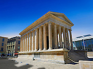 Exterior of the Maison Carrée, a ancient Roman temple built around 4-7 AD and dedicated to Julius Caesar, the best preserved example of a Roman temple,  Nimes, France . In about 4-7 AD, the Maison Carrée was dedicated or rededicated to Gaius Caesar and Lucius Caesar, grandsons and adopted heirs of Augustus who both died young. The Maison Carrée is a classic example of Vitruvian architecture as it is nearly an exact replica of a Tuscan style Roman temple described in the writings of the famous architect Vitruvius. Raised on a 2.85 m high podium, and at 26.42 m by 13.54 m forming a rectangle almost twice as long as it is wide, the temple dominated the forum of the Roman city of Nîmes. .<br /> <br /> Visit our ROMAN ART & HISTORIC SITES PHOTO COLLECTIONS for more photos to download or buy as wall art prints https://funkystock.photoshelter.com/gallery-collection/The-Romans-Art-Artefacts-Antiquities-Historic-Sites-Pictures-Images/C0000r2uLJJo9_s0