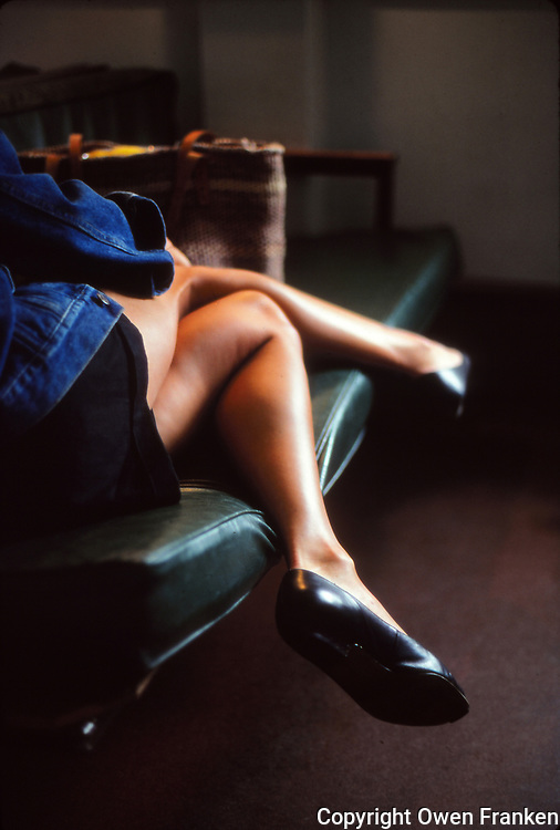 A woman's legs, sitting on a couch