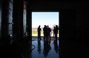 The Pisano brothers and visitors in silhouette at the winery door. Bodega Pisano Winery, Progreso, Uruguay, South America