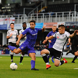 TELFORD COPYRIGHT MIKE SHERIDAN Adam Walker of Telford shoots at goal under pressure from Keiran Thomas of Hereford during the National League North fixture between Hereford FC and AFC Telford United at Edgar Street, Hereford on Tuesday, August 13, 2019<br /> <br /> Picture credit: Mike Sheridan<br /> <br /> MS201920-009