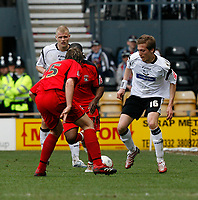 Photo: Steve Bond.<br />Derby County v Coventry City. Coca Cola Championship. 09/04/2007. Arturo Lupoli (R) attacks defender Adam Virgo (L)