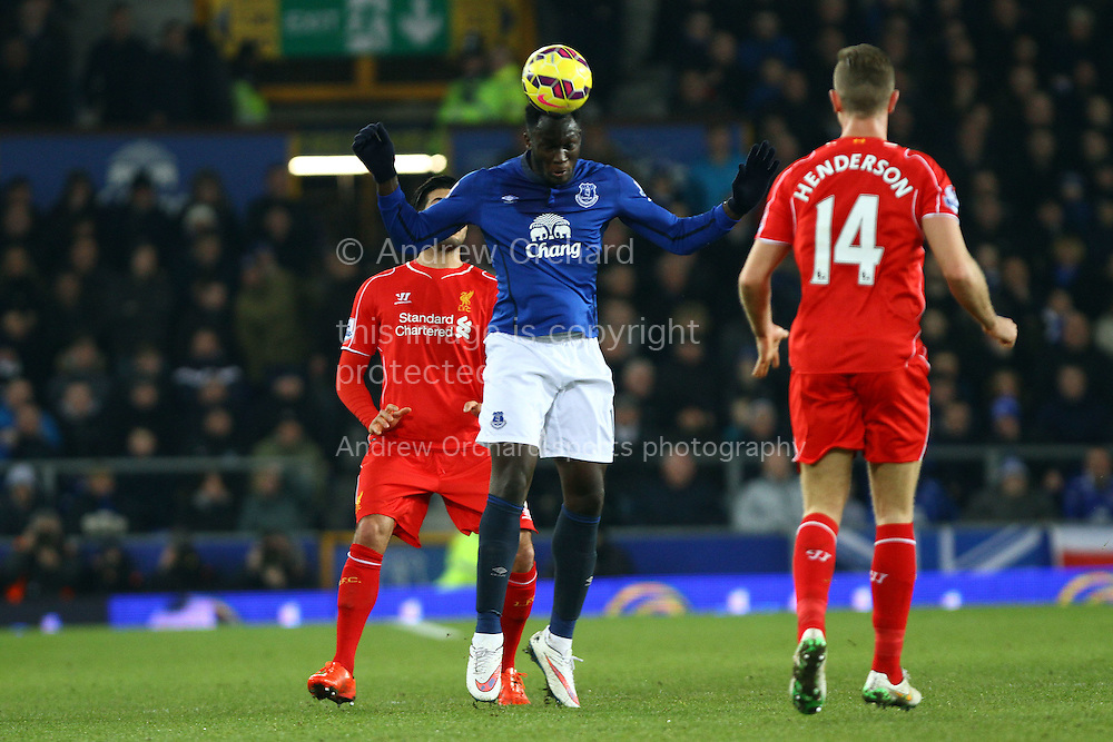 Romelu Lukaku of Everton heads the ball. Barclays Premier league match, Everton v Liverpool at Goodison Park in Liverpool, Merseyside on Saturday 7th February 2015<br /> pic by Chris Stading, Andrew Orchard sports photography.