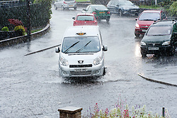 16:41 Ecclesfield Sheffield UK.The drains in the street have reached the point they cant cope with the amount of water and the road is beginning to flood..5 July 2012.Image © Paul David Drabble