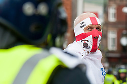 """An EDL supporter and Police in full Riot kit on the streets close to Rotherham Town Hall shortly before the start of the English Defence Leagues """"Justice for the Rotherham 1400"""" March on Saturday Afternoon which was described by an EDL Facebook Page as """"a protest against the Pakistani Muslim grooming gangs"""" <br /> <br /> Image © Paul David Drabble <br /> www.pauldaviddrabble.co.uk"""