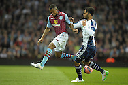 Leandro Bacuna of Aston Villa is challenged  by Joleon Lescott of West Bromwich Albion. The FA cup, 6th round match, Aston Villa v West Bromwich Albion at Villa Park in Birmingham, Midlands on Saturday 7th March 2015<br /> pic by John Patrick Fletcher, Andrew Orchard sports photography.