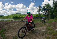 Sara Caveney guides an EBike tour around Rock Loop Trail at Gunstock on Tuesday morning.  (Karen Bobotas/for the Laconia Daily Sun)