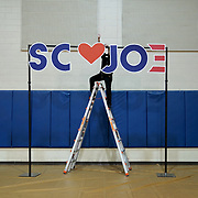 A sign is adjusted before Democratic presidential candidate Joe Biden community event with actress Vivica Fox at Costal Carolina University in Conway, S.C., on Thursday, February 27, 2020.