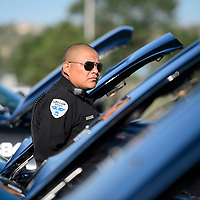 080614       Cayla Nimmo<br /> <br /> Officer Jeremy Shirley with the Gallup Police Department stands in front of his cruiser for inspection Wednesday morning at the Gallup Police Station.