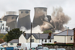 © Licensed to London News Pictures. 13/10/2019. Knottingley, UK. Four of the remaining seven cooling towers have been blown down this morning at the now defunct Ferrybridge coal power station near Knottingley in Yorkshire. The towers stood at 114 metres tall & have dominated the Yorkshire sky line for more than 50 years. Photo credit: Andrew McCaren/LNP