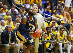 Dec 8, 2018; Morgantown, WV, USA; Pittsburgh Panthers guard Jared Wilson-Frame (4) shoots from the corner during the first half against the West Virginia Mountaineers at WVU Coliseum. Mandatory Credit: Ben Queen-USA TODAY Sports