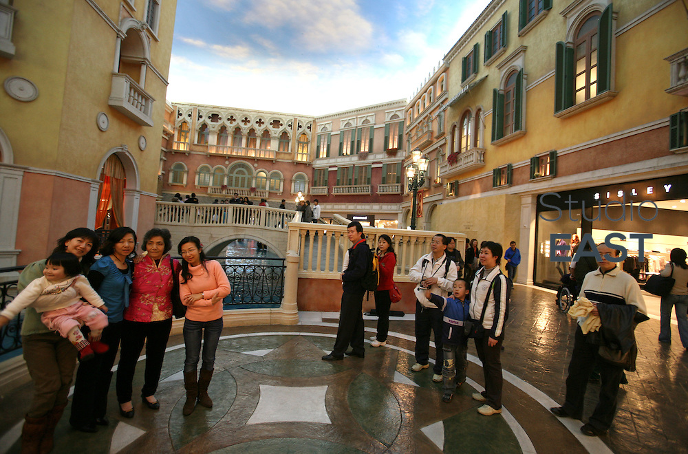 MACAU, CHINA - February 24: Customers visit the Venetian casino's shopping mall on February 24, 2008 in Macau, China. The Venetian Macao-Resort-Hotel is a 163,000 square foot casino featuring 405 slots and 277 table games. Macao has overtaken Las Vegas with a gambling revenue of 7 billion U.S. dollars in 2006 (Las Vegas' was 6.6 billion U.S. dollars), and is now the world's top casino hut. (Photo by Lucas Schifres/Getty Images)