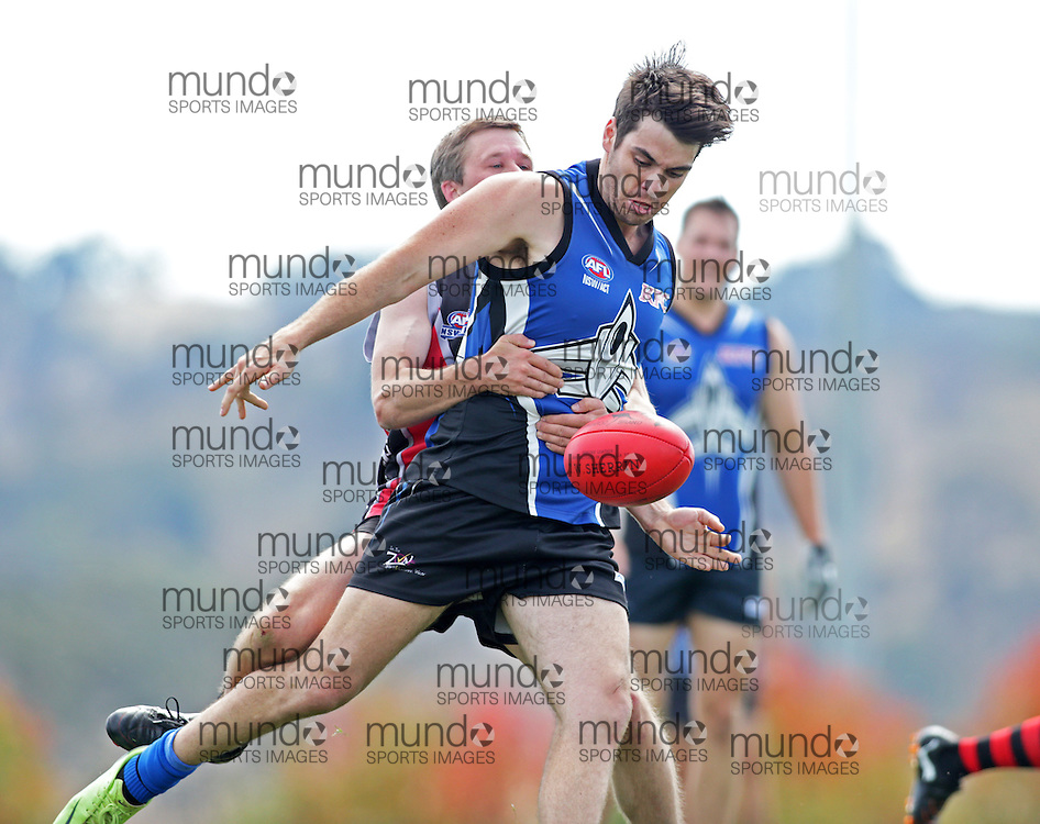 (Canberra, Australia---14 April 2013)  Gunghalin Jets versus Murrumbidgee in the Division Three ACT/NSW Australian Rules Football action at the Amaroo Oval.