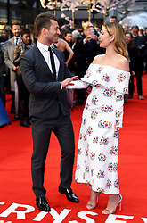 Glen Powell (left) and Lily James (right) attending the world premiere of The Guernsey Literary and Potato Peel Pie Society at the Curzon Mayfair, London. Photo credit should read: Doug Peters/EMPICS Entertainment