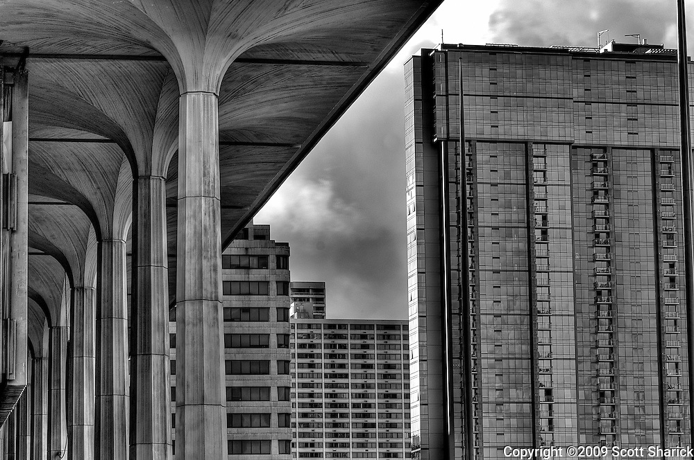 A black and white HDR image of the Hawaii State Capital and downtown Honolulu.