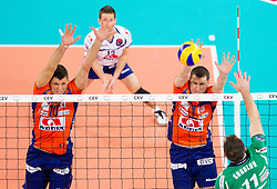 Borislav Petrovic of ACH and Andrej Flajs of ACH bs Tsvetan Sokolov of Cuneo during volleyball match between ACH Volley Ljubljana and Bre Banca Lannutti Cuneo (ITA) in Playoff 12 game of CEV Champions League 2012/13 on January 15, 2013 in Arena Stozice, Ljubljana, Slovenia. (Photo By Vid Ponikvar / Sportida.com)