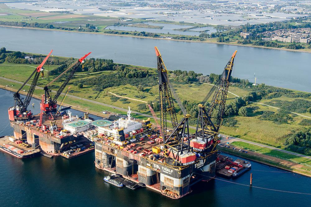 Nederland, Zuid-Holland, Rotterdam, 28-09-2014; Rozenburg, Callandkanaal met Nieuwe Waterweg in de achtergrond. Offshoreschepen van Heerema,<br /> de Hermod (links) en de Thialf. Beide vaartuigen zijn semi-submersible kraanschepen (half-afzinkbaar kraanschip).<br /> Offshore vessels, semi-submersible crane vessels.<br /> luchtfoto (toeslag op standard tarieven);<br /> aerial photo (additional fee required);<br /> copyright foto/photo Siebe Swart