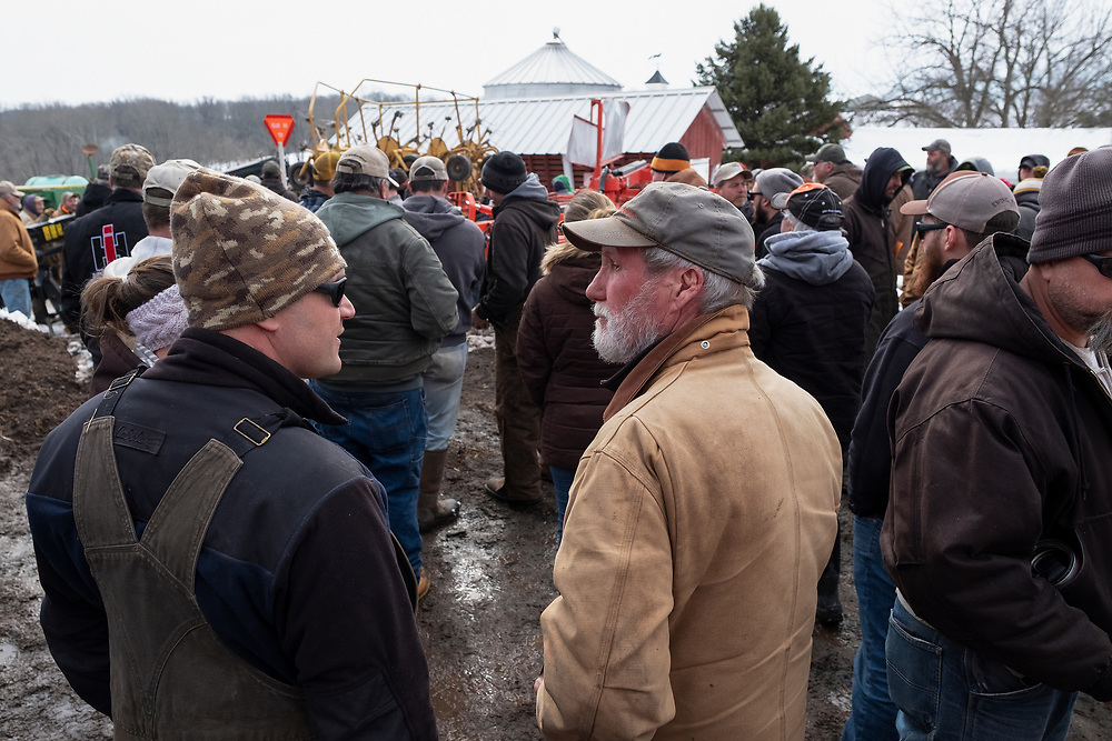 Farmer Mike Mathews, right, stands by during an auction of his equipment on March 8, 2019, in Pittstown, New Jersey.