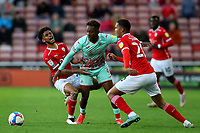 Football - 2020 / 2021 Sky Bet Championship - Play-offs - Semi-final 1st Leg - Barnsley vs Swansea City - Oakwell<br /> <br /> Jamal Lowe of Swansea City competes with Romal Palmer and Toby Sibbick of Barnsley