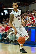 DALLAS, TX - JANUARY 4: Shabazz Napier #13 of the Connecticut Huskies brings the ball up court against the SMU Mustangs on January 4, 2014 at Moody Coliseum in Dallas, Texas.  (Photo by Cooper Neill) *** Local Caption *** Shabazz Napier