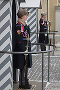 Uniformed guards the nearest, a woman wear the Ruritanian-style uniforms outside Prague Castle, at Hradcany-Prazsky Hrad Prague Castle, on 18th March, 2018, in Prague, the Czech Republic. Ater the Velvet Revolution in 1990 when the communist regime ended, Václav Havel, the first President of the Czech Republic wanted his guards's uniforms to be different from the khaki ones the communists wore and the basic ones found in neighboring countries. Havel chose Theodor Pistek, the Czech born artist and costume designer who won an Academy Award for Best Costume Design for the 1984 film Amadeus.
